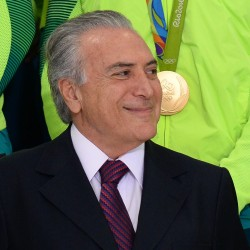 Brazilian acting President Michel Temer attends a ceremony with the Rio2016 Olympic medalists, in Brasilia, on August 29, 2016. / AFP PHOTO / ANDRESSA ANHOLETE