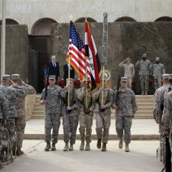 RETRANSMITTING TO CLARIFY PHOTO SHOWS U.S. FORCES-IRAQ COLORS BEING CARRIED AFTER CASING CEREMONY NOT BEFORE The US flag, Iraq flag, and the U.S. Forces-Iraq colors are carried during ceremonies marking the end of US military mission in Baghdad, Iraq, Thursday, Dec. 15, 2011. After nearly nine years, 4,500 American dead, 32,000 wounded and more than $800 billion, U.S. officials formally shut down the war in Iraq a conflict that U.S. Defense Secretary Leon Panetta said was worth the price in blood and money, as it set Iraq on a path to democracy. (AP Photo/Khalid Mohammed)